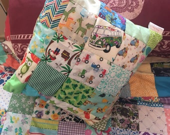 Small green themed patchwork cushion