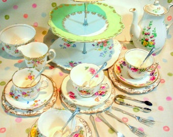 Pretty green and lemon bone china mismtached 26 piece tea service with cake stand and coffee pot.