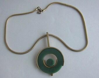 RAS neck 60's gold metal and green Bakelite