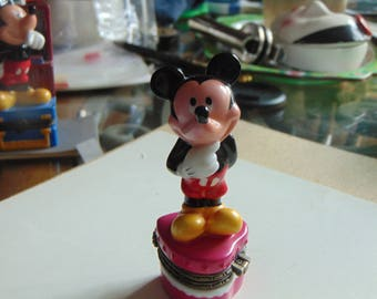 Mickey Mouse waiting for Minnie to surprising.   her with a lovely Valentine.  Trinket box