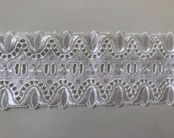 Lace white broderie anglaise with past 7.5 cm wide ribbon in between