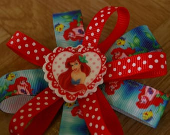 The little mermaid stacked flower hair bow, with your choice of 3 Ariel buttons, on a hair clip or headband.