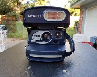 Round polaroid 600 camera
