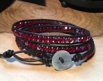 Red faceted glass and leather wrap bracelet