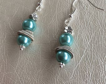 Turquoise pearl earrings. Silver embellishment on silver ear wires.