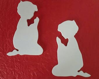 silhouette of child in prayer, trimmed in 3 mm medium and painted by hand
