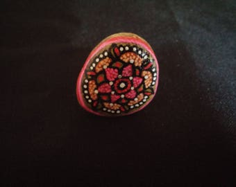 Pebble ring painted with a pink flower mandala