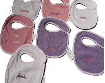 7 bibs embroidered with machine embroidery