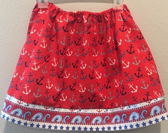 4th of July red, white, and blue skirt with anchors on red background and a trim of sailor accents