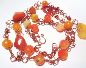 Necklace made with copper wire technique with agate and carnelian