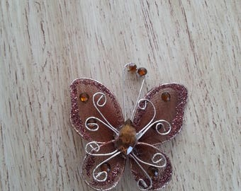 Fabric butterfly and rhinestones creating Brown jewelry