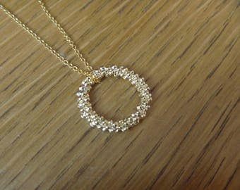 Gold round necklace
