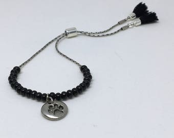 Adjustable bracelet, tube slide clasp with paw charm and little tassel