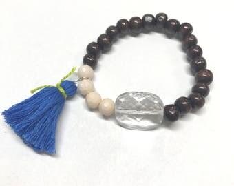 Cream, blue, and wood bead bracelet