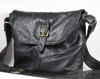 Ultra soft upcycled leather messanger bag from repurposed jacket with wide cross-body strap.