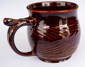 Cup of ceramics with pattern.