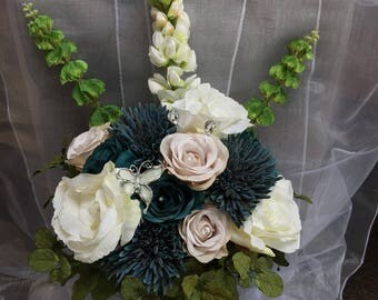 Beautiful front facing teal and vintage rose brides bouquet