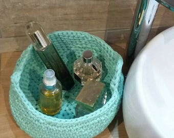 Green color storage basket with water