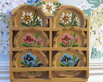 Vintage hand painted folk style wooden coasters in a wall hanging holder. Beautiful bright  floral detailing
