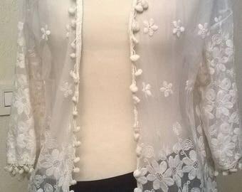 Cream colored lace vest
