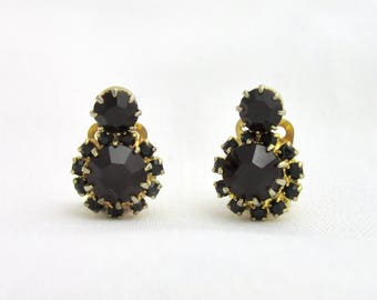 Garnet color stones and gold tone clip earrings