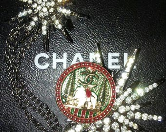 Chanel elephant button and vintage rhinestone burst two pin brooch