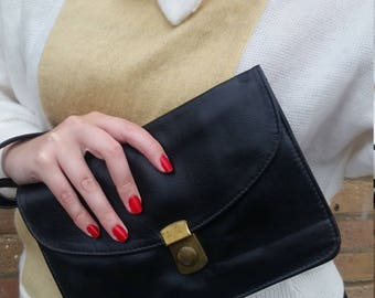 Black leather clutch with brass closure
