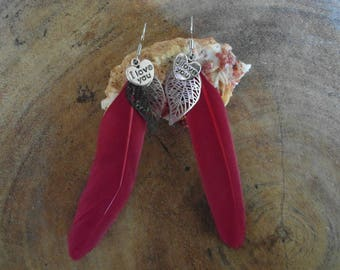 Feather earrings with red and silver charms hanging