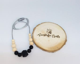 Silicone bead necklace with raw, natural wooden beads. 3 colour choices.