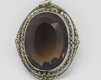 Pendant with a smoky quartz 925 hand work