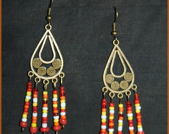 "Earrings ""Gold in I"" and waterfalls of beads"