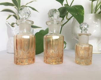 Set circa 30-40 colored and etched glass perfume bottle