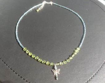 Peridot and  sterling silver butterfly pendant necklace.  17 inch, extending to 19 inch. Dainty peridot beads on pale blue seed bead strand.