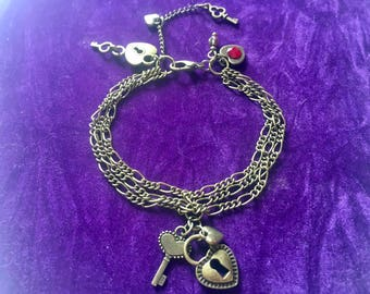 Alice In Wonderland Queen of Hearts bronze charm bracelet