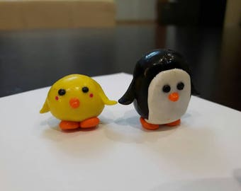 A Polymer Clay Yellow Bird and Penguin.