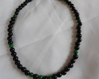 Black and green man necklace, acai seeds and jade.