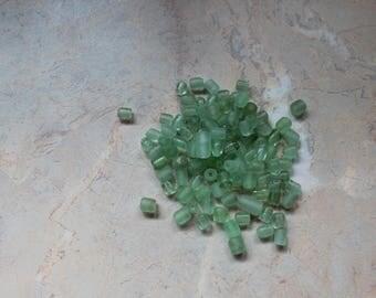 Assortment of 100 glass beads, green. 6mm