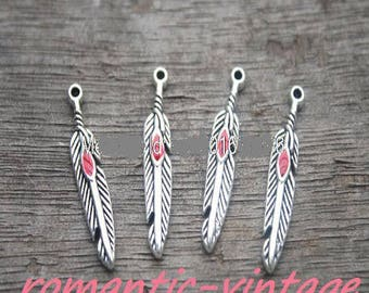 5 red enamel feathers and 27 * 6mm antique silver charms