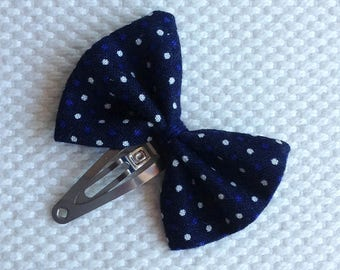 Navy blue bow hair clip with polka dots