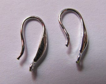 pair of silver colored earrings