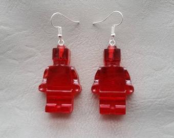 Pierced ears snowman toy red plastic