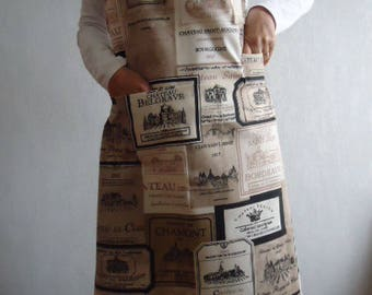 Beige and black apron with wine labels