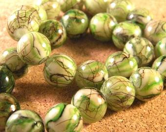 glass 12 mm Green speckled black - PE99 trefilee 10 beads