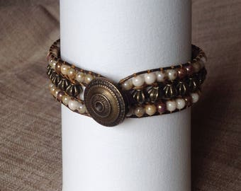 Leather, beads and button wrap bracelet bronze, Czech pearl beads.