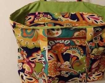 Large tote. Many pockets. Outside Zipper pocket. Zipper enclosure. Inside pockets. Large bag. Fully lined.