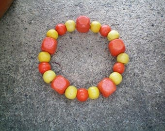 Bracelet with yellow and orange wooden beads