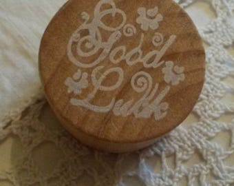 "Wooden stamp / message ""Good Luck"" in ink"