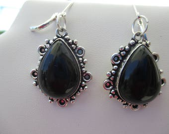 pair of silver and onyx earrings