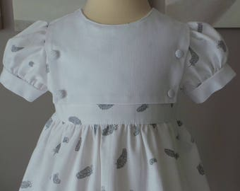dress 12 months motifs and white cotton pique feathers