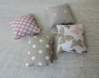 Set of four pillows scented with the essence of roses sewn hands